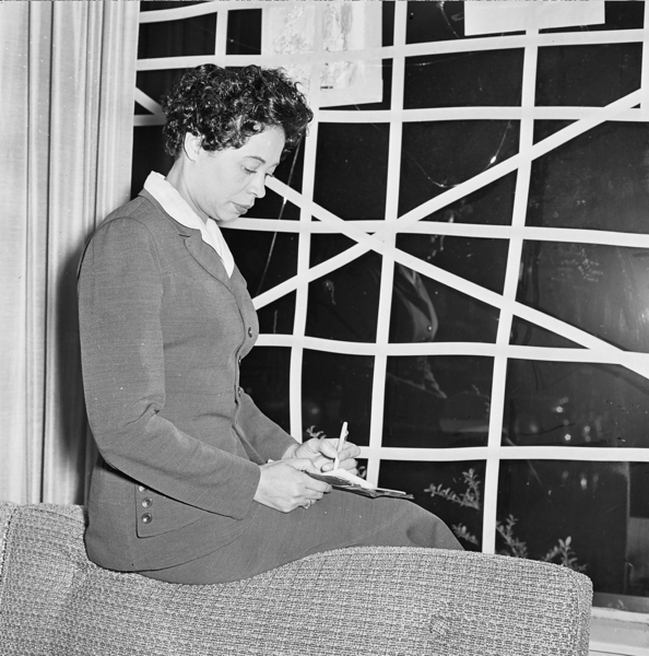Daisy Bates Reflects by Window